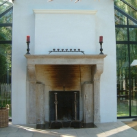 Fine French Country Vintage Antique Fireplace Surround in Limestone used as an open fireplace.
