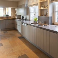 ancient surface tiles in natural stone in a timeless kitchen interior design.