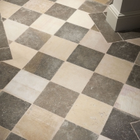 Antique recut flooring in a checkboard style with border in French limestone.