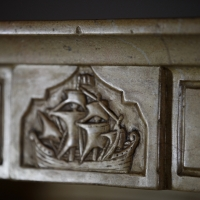 Fine Burgundy Vintage French Stone Fireplace With Sailor Boat Detail