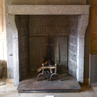 Fine European antique fireplace in Fossil Limestone in a Chalet in the Suisse Mountains