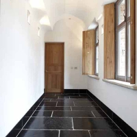 Timeless Hall With Vintage Ancient Surfaces In Black Belgian Marble By Maison Leon Van den Bogaert